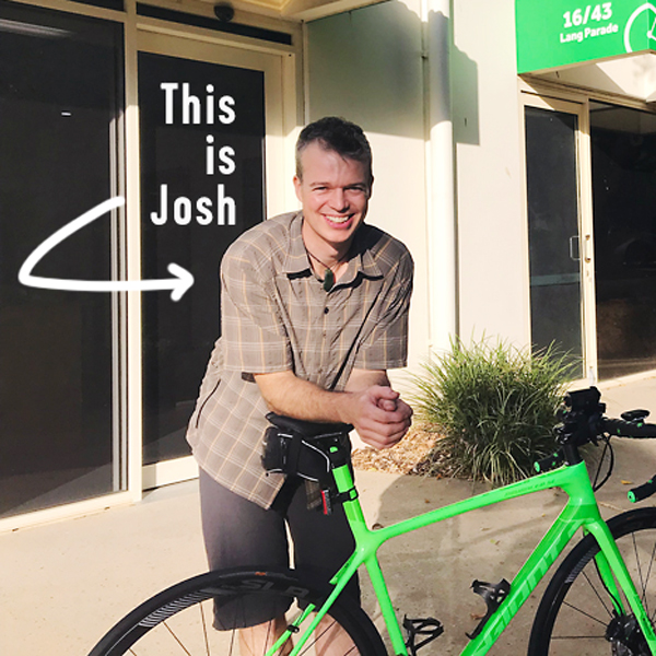 Josh Harris, resident bike mechanic, pictured with bike at the front of Bicycle Queensland, Milton